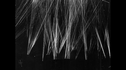 US anti-aircraft tracers light the sky over Iwo Jima as American forces repel a Japanese air attack.