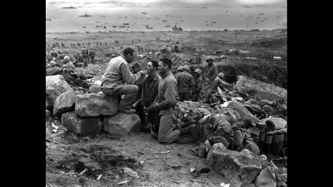 Marines receive communion from a Marine chaplain on March 3, 1945.