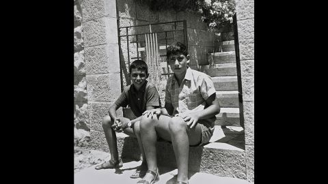 Netanyahu, right, sits with a friend at the entrance to his family home in Jerusalem on July 1, 1967. The Israeli prime minister was born October 21, 1949.