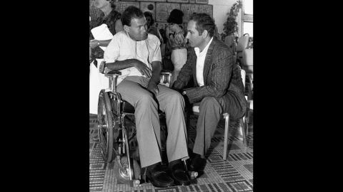 Netanyahu speaks in July 1986 with Sorin Hershko, one of the Israeli soldiers wounded in Operation Entebbe. It was the 10th anniversary of Operation Entebbe, a dramatic rescue of Jewish hostages at Uganda's Entebbe Airport.  Netanyahu's brother, Yonatan, was killed leading Operation Entebbe in 1976. Affected by his brother's death, Netanyahu organized two international conferences on ways to combat terrorism, one in 1979 and another in 1984.