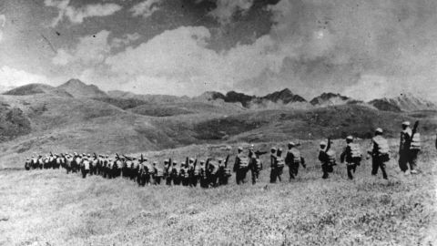 Chinese troops march over the highlands after their invasion of Tibet in 1950. At age 15, the Dalai Lama assumed full political power ahead of schedule. His investiture was moved up from his 18th birthday as a result of China's invasion.