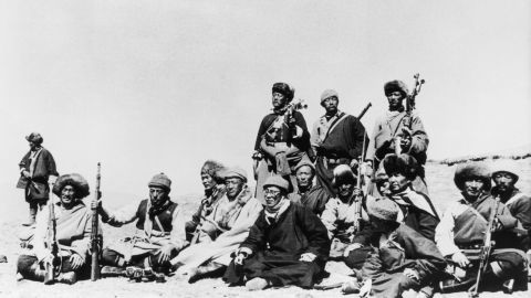 Fearing for his life, the Dalai Lama (sixth from left) flees Tibet in March 1959 and heads across the Himalayas to India disguised as a soldier. The Dalai Lama has long denied China's assertion that he's seeking Tibetan independence. He says he wants only enough autonomy to protect its traditional Buddhist culture. Beijing rejects accusations of oppression, saying that under its rule, living standards have greatly improved for the Tibetan people. It makes centuries-old historical claims on the region.