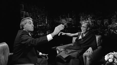 """TV talk show host Tom Snyder shares a joke with the Dalai Lama in 1979 during a taping of NBC's """"Tomorrow."""" The Dalai Lama was in New York during a 49-day tour of the United States."""