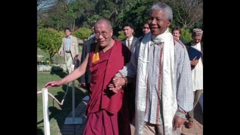 """In 1996, the Dalai Lama meets with <a href=""""https://www.cnn.com/2013/03/28/africa/gallery/nelson-mandela/index.html"""" target=""""_blank"""">Nelson Mandela</a>, the prisoner-turned president who reconciled South Africa after the end of apartheid."""