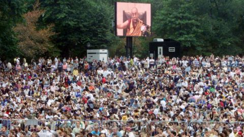 A crowd gathers at New York's Central Park to listen to the Dalai Lama speak in 1999. In 2002, he speaks out against China, stating that China should embrace democracy if the country is to be a major world power in the coming years. He also criticizes the United States-led war on terrorism, saying that the use of force to override terrorists overlooks the underlying problems that lead to terrorism.