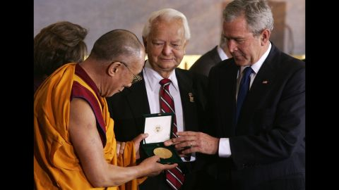 """<a href=""""https://www.cnn.com/2013/07/07/us/george-w-bush-fast-facts/index.html"""">United States President George W. Bush</a> presents the Dalai Lama with the Congressional Gold Medal in 2007."""