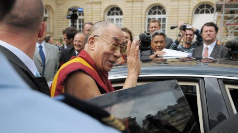 The Dalai Lama leaves the French senate in Paris after a meeting with lawmakers at the height of the Beijing Olympics in 2008. Tibet-related protests disrupted several stages of the worldwide Olympic torch relay in the run-up to the Games.