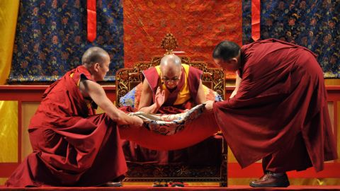 The Dalai Lama blesses gifts during a ceremony in September 2009 to comfort victims of Typhoon Morakot in Kaohsiung, Taiwan.