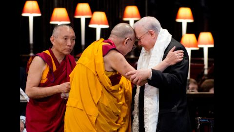 """The Dalai Lama embraces John Templeton after receiving the Templeton Prize during a ceremony at St. Paul's Cathedral in London on May 14, 2012. The award honors """"outstanding individuals who have devoted their talents to expanding our vision of human purpose and ultimate reality."""""""