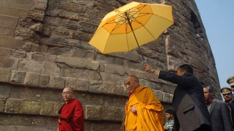 """The Dalai Lama visits the Dhamek Stupa in Sarnath, India, on January 11, 2013. The area is said to mark the spot where Buddha first addressed disciples after attaining enlightenment. In 2013, a senior Chinese official said, """"The Dalai Lama has long been engaged in secessionist activities, which run against both the common interests of people of various ethnic groups and the traditions of Tibetan Buddhism."""""""