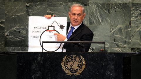 """Netanyahu uses a diagram of a bomb to describe Iran's nuclear program while delivering an address to the UN General Assembly on September 27, 2012. Netanyahu exhorted the General Assembly to draw """"a clear red line"""" to stop Iran from developing nuclear weapons."""