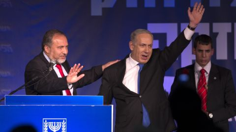 Netanyahu and Avigdor Lieberman of the Likud-Beiteinu coalition party greet supporters as they arrive onstage on election night in January 2013. The Likud-Beiteinu won 31 seats in the Knesset.