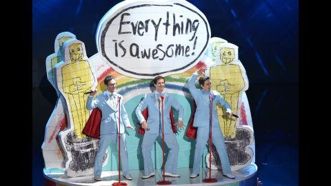 """From left, Akiva Schaffer, Andy Samberg and Jorma Taccone of The Lonely Island take the stage for a rendition of the Oscar-nominated Tegan and Sara song """"Everything is Awesome"""" from """"The Lego Movie."""""""