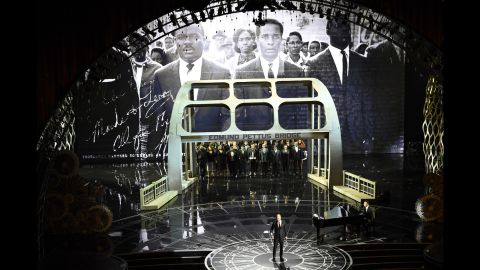 """Legend and Common perform """"Glory,"""" their winning song from the film """"Selma."""" The performance earned a standing ovation and brought some in the audience to tears -- including Oyelowo, who stars in the film as <a href=""""http://www.cnn.com/2013/08/28/us/gallery/martin-luther-king-jr/index.html"""">Martin Luther King Jr</a>."""