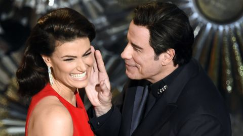 "John Travolta and Idina Menzel present an award together, <a href=""http://www.cnn.com/2014/03/04/showbiz/john-travolta-idina-menzel-oscars/index.html"" target=""_blank"">referencing last year's flub</a> when he mispronounced her name."