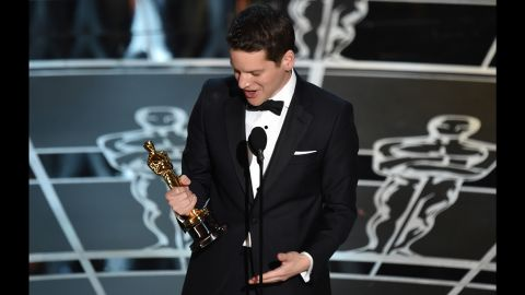 """""""The Imitation Game"""" screenwriter Graham Moore accepts the award for the best adapted screenplay. """"When I was 16 years old, I tried to kill myself because I felt weird. And I felt different. And I felt like I didn't belong,"""" he said. """"And now I'm standing here, and so I would like for this moment to be for that kid out there who feels like she's weird or she's different or she doesn't fit in anywhere. Yes, you do. I promise you do. You do. Stay weird; stay different."""""""