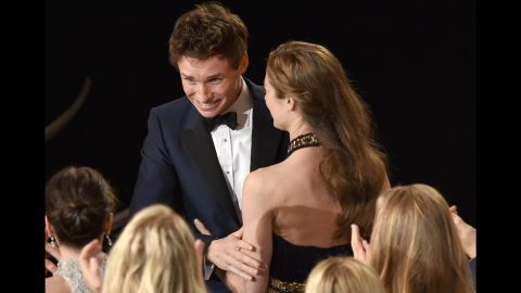 """Eddie Redmayne is congratulated after winning best actor for his performance as Stephen Hawking in """"The Theory of Everything."""""""