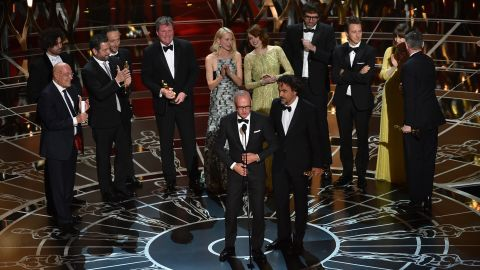 """Michael Keaton, front left, and """"Birdman"""" director Alejandro Gonzalez Iñarritu accept the Academy Award for best picture along with other members of the film's cast and crew. """"Birdman"""" also won three other Oscars: best director, best cinematography and best original screenplay."""