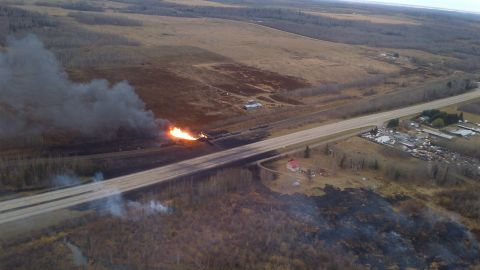 Fire erupted after a train carrying oil and gas derailed in Gainford, Alberta, in October 2013.