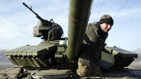 A Ukrainian serviceman climbs out of a tank at a checkpoint near Horlivka, Ukraine, on Monday, February 23.