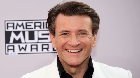 """Entrepreneur and """"Shark Tank"""" panelist Robert Herjavec got kicked of the show but may have won in another realm: He's reportedly dating his partner, pro dancer Kym Johnson."""