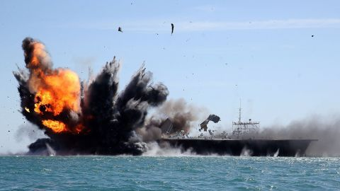 Iran's elite Revolutionary Guard troops attack a mock-up of the aircraft carrier USS Nimitz during a military drill in the Strait of Hormuz in Iran on Wednesday, February 25.