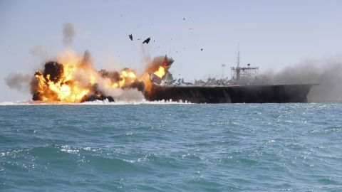 The mock U.S. aircraft carrier explodes during the large-scale naval drills near the entrance of the Persian Gulf. The drill, named Great Prophet 9, was the first to involve a replica of a U.S. carrier.