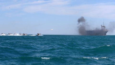 Revolutionary Guard troops use speed boats to attack the vessel.