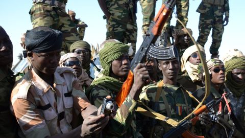 Chadian soldiers gather on February 1, 2015 near the Nigerian town of Gamboru, just accros the border from Cameroon. In a deserted Gamboru, Chadian forces carried out clean-up operations after entering the town and retaking it from Boko Haram, which seized control months ago