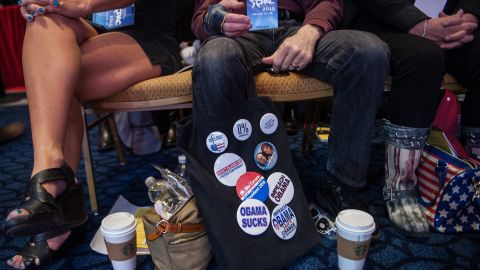 A man displays pins as he attends the annual Conservative Political Action Conference.