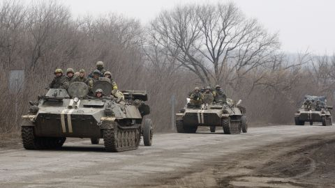 Ukrainian armored personnel carriers move cannons from their position near the eastern Ukrainian city of Artemivsk, in the Donetsk region on February 26, 2015.