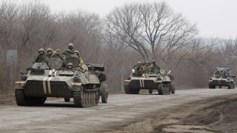 Ukrainian Armoured Personnel Carriers move cannons from their position near eastern Ukrainian city of Artemivsk, in the Donetsk region on February 26, 2015.