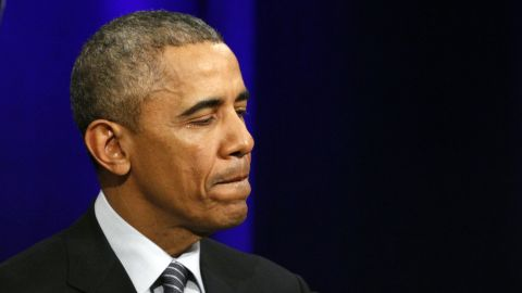 President Barack Obama pauses as he speaks about outgoing Attorney General Eric Holder at an event celebrating Holder at the Department of Justice in Washington, Friday, Feb. 27, 2015. (AP Photo/Jacquelyn Martin)