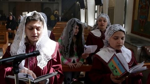 Displaced Assyrian women who fled their homes due to ISIS attacks pray at a church on the outskirts of Damascus, Syria, on Sunday, March 1. ISIS militants abducted at least 220 Assyrians in Syria.