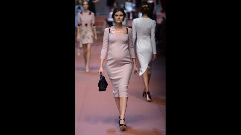 Italian model Bianca Balti walks the Dolce & Gabbana runway while pregnant with her second child.