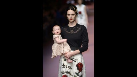 Model Ashleigh Good walks the runway with her daughter for fashion house Dolce & Gabbana.