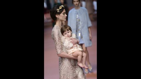A model and baby wear matching Italian lace dresses.