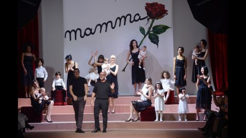 Stefano Gabbana and Domenico Dolce come out to applause at the end of their show during Milan Fashion Week.