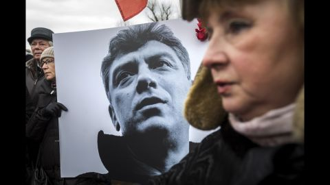 A woman carries a sign with Nemtsov's image during a march in St. Petersburg, Russia, on March 1.