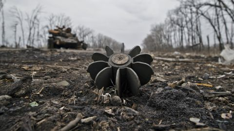 A mortar round sticks out of the ground near a destroyed tank at a former Ukrainian army checkpoint outside Chornukhyne, Ukraine, on Monday, March 2. Russian-backed separatists had recently overran the area.
