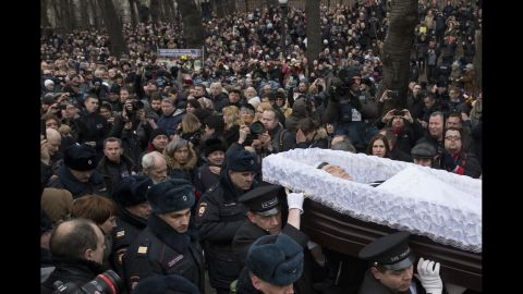 People follow the coffin of Russian opposition leader Boris Nemtsov during a farewell ceremony in Moscow on Tuesday, March 3. Nemtsov, a vocal opponent of Russian President Vladimir Putin's, was gunned down hundreds of feet away from the Kremlin on Friday, February 27. The assassination has spawned a flood of conspiracy theories; many suspect the Kremlin of either direct or indirect involvement. Putin condemned the killing and ordered three law enforcement agencies to investigate, the Kremlin said.