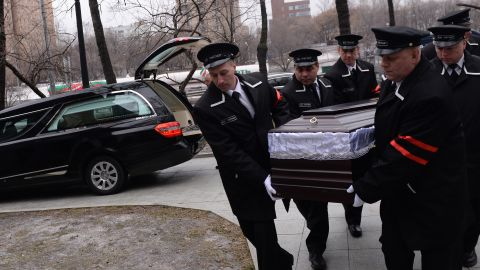 Caption:Funeral assistants carry the coffin of Russian opposition leader Boris Nemtsov before a farewell ceremony in Moscow on March 3, 2015. Russia vowed on March 2 to find the killers of outspoken opposition leader Boris Nemtsov as fresh details emerged about the most shocking political assassination during Vladimir Putin's rule. Nemtsov's body will lie in state on March 3 at the Andrei Sakharov rights centre in Moscow, followed by his burial at the city's Troekurovskoye cemetery. AFP PHOTO / ALEXANDER UTKIN (Photo credit should read ALEXANDER UTKIN/AFP/Getty Images)