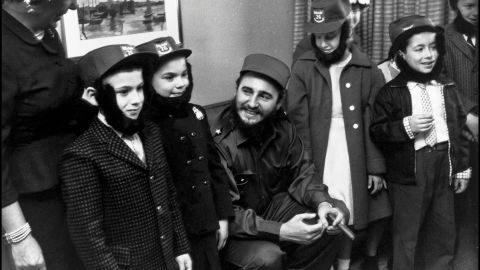 During a visit to New York in 1959, Fidel Castro spends time with a group of children.