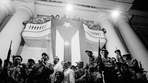 Surrounded by rebels who came with him from the mountains, Castro gives an all-night speech.