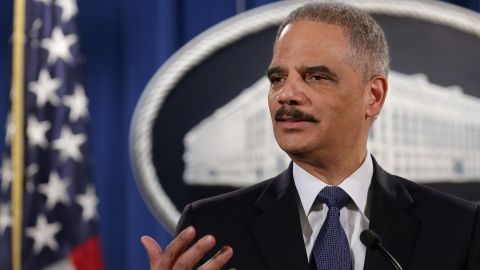WASHINGTON, DC - MARCH 04: Attorney General Eric Holder delivers remarks about the Justice Department's findings related to two investigations in Ferguson, Missouri, at the Robert F. Kennedy Department of Justice Building March 4, 2015 in Washington, DC. Holder delivered the remarks for an audience of department employees who worked on the investigations after a white police officer shot and killed an unarmed black teenager, sparking weeks of demonstrations and violent clashes.