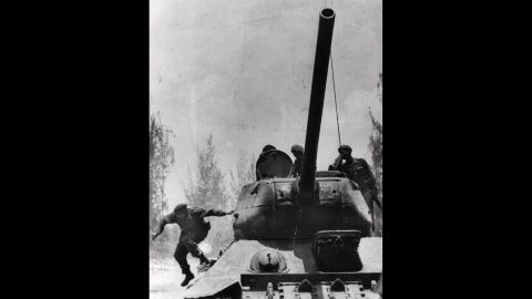 Castro jumps from a tank in April 1961 as he arrives at Giron, Cuba, near the Bay of Pigs. That month, a group of about 1,300 Cuban exiles, armed with US weapons, made an unsuccessful attempt to overthrow Castro.