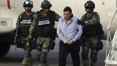 The alleged leader of the Zetas drug cartel, Omar Trevino Morales, aka 'Z-42' is taken under custody at the Attorney General Office's hangar at the airport in Mexico City.