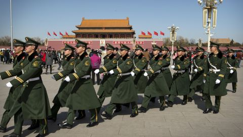 Paramilitary policemen march in formation across Tiananmen Square in Beijing Wednesday, March 4, 2015. Thousands of delegates from all over the country are in the Chinese capital this week to attend the Chinese People's Political Consultative Conference and the National People's Congress. (AP Photo/Mark Schiefelbein)
