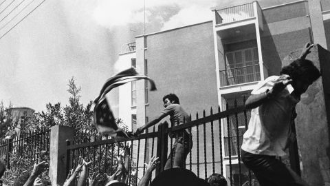 Angry demonstrators rip the American flag from the United States Embassy in Nicosia, Cyprus, on August 19, 1974, during a demonstration against American policy on Cyprus. Rodger Davies, the U.S. ambassador to Cyprus, was killed by gunfire during the incident.