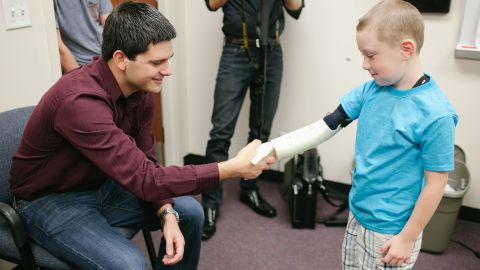 """<a href=""""http://www.limbitless-solutions.org/"""" target=""""_blank"""" target=""""_blank"""">Albert Manero and a team of engineering students</a> at University of Central Florida designed a prototype for an electronic arm. Six-year-old Alex Pring was the first recipient. Rather than profiting from the designs, the students uploaded them to the Internet for anyone to use."""